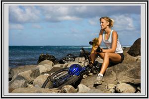 lady biker sitting near ocean on rocks