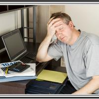 sleepy guy sitting at desk
