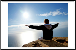 person meditating at sunrise