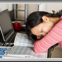 Lady sleeping at her computer