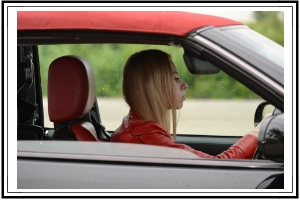 blonde lady driving car