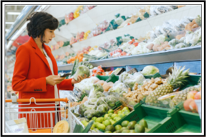 lady shopping at the grocery store in the vegetable section